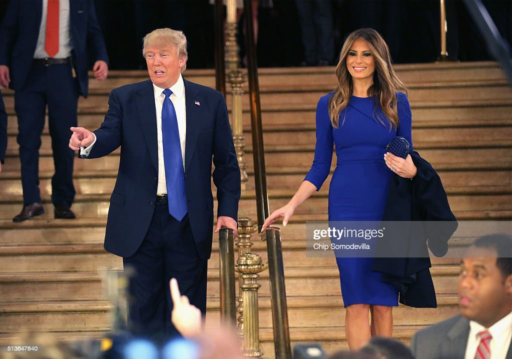 Republican presidential candidate Donald Trump and his wife Melania greet reporters in the spin room following a debate sponsored by Fox News at the...