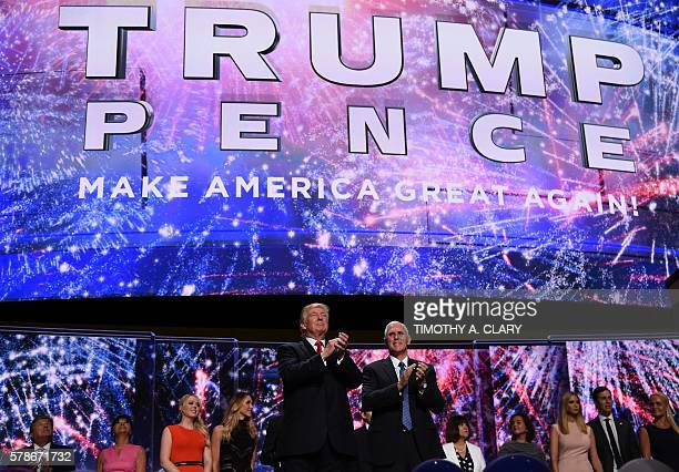 Republican presidential candidate Donald Trump and Indiana Governor Mike Pence gesture to the audience after they accepted the party nomination on...