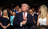 Republican presidential candidate Donald Trump and Ivanka Trump stand as Eric Trump delivers his speech during the third day of the Republican...