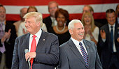 Republican presidential candidate Donald Trump and Republican vice presidential candidate Mike Pence react to a question from a young boy in the...