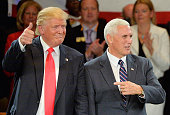 Republican presidential candidate Donald Trump and Republican vice presidential candidate Mike Pence react to the cheers at a campaign stop at...
