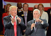 Republican presidential candidate Donald Trump and Republican vice presidential candidate Mike Pence take questions from the audience during a town...