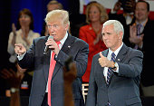 Republican presidential candidate Donald Trump and Republican vice presidential candidate Mike Pence take questions from the audience at the The...