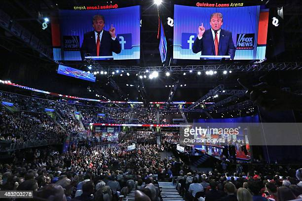 Republican presidential candidate Donald Trump appears on the large video screen hanging abouve the first primetime presidential debate hosted by FOX...