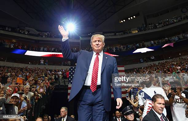 Republican presidential candidate Donald Trump arrives at a campaign rally at the American Airlines Center on September 14 2015 in Dallas Texas More...