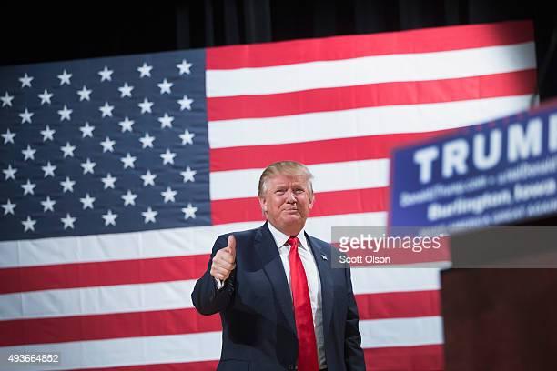 Republican presidential candidate Donald Trump arrives at a campaign rally at Burlington Memorial Auditorium on October 21 2015 in Burlington Iowa...