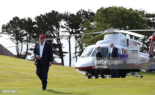 Republican Presidential Candidate Donald Trump arrives by helicopter to visit his Scottish golf course Turnberry on July 30 2015 in Ayr Scotland...