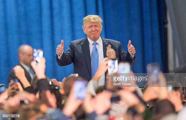 Republican presidential candidate Donald Trump arrives for a campaign event at Mississippi Valley Fairgrounds on December 5 2015 in Davenport Iowa...