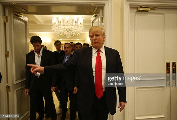 Republican presidential candidate Donald Trump arrives for a press conference at the Trump National Golf Club Jupiter on March 8 2016 in Jupiter...