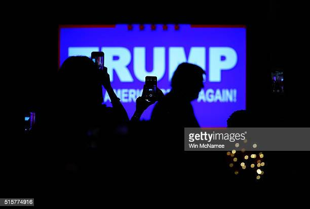 Republican presidential candidate Donald Trump arrives for a primary night press conference at the MarALago Club's Donald J Trump Ballroom March 15...