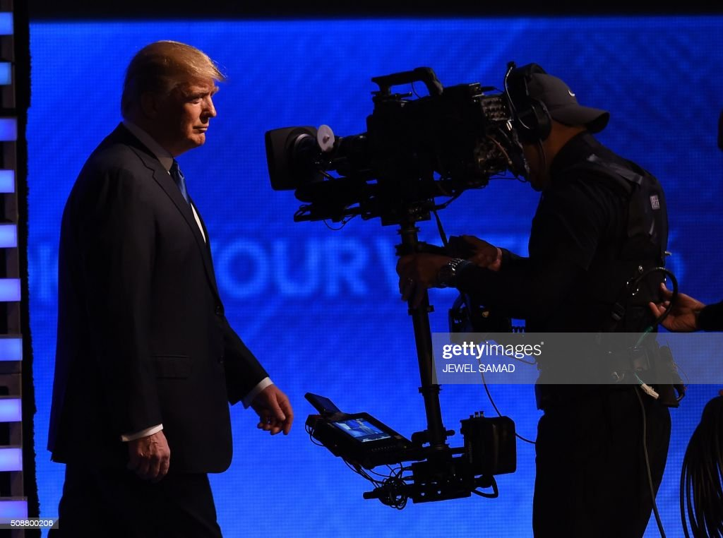 Republican presidential candidate Donald Trump arrives for the Republican Presidential Candidates Debate on February 6, 2016 at St. Anselm's College Institute of Politics in Manchester, New Hampshire. Seven Republicans campaigning to be US president are in a fight for survival in their last debate Saturday before the New Hampshire primary, battling to win over a significant number of undecided voters. / AFP / Jewel Samad