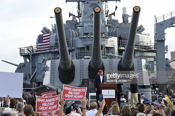 Republican presidential candidate Donald Trump arrives to give a national security speech aboard the World War II Battleship USS Iowa on September 15...