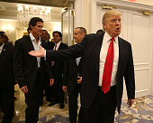 Republican presidential candidate Donald Trump arrives with former Yankee baseball player Paul O'Neill for a press conference at the Trump National...