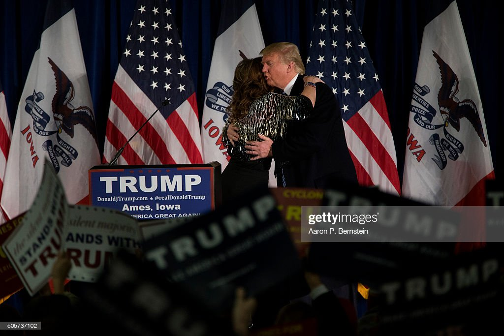 Republican presidential candidate <a gi-track='captionPersonalityLinkClicked' href=/galleries/search?phrase=Donald+Trump+-+Born+1946&family=editorial&specificpeople=118600 ng-click='$event.stopPropagation()'>Donald Trump</a> embraces former Gov. <a gi-track='captionPersonalityLinkClicked' href=/galleries/search?phrase=Sarah+Palin&family=editorial&specificpeople=4170348 ng-click='$event.stopPropagation()'>Sarah Palin</a> at Hansen Agriculture Student Learning Center at Iowa State University on January 19, 2016 in Ames, IA. Trump received Palin's endorsement at the event.