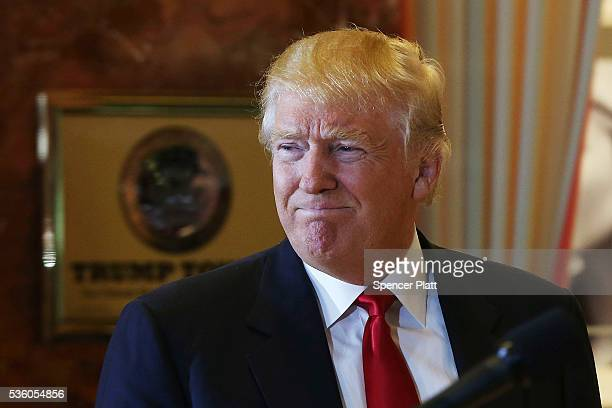 Republican presidential candidate Donald Trump enters a news conference at Trump Tower where he addressed issues about the money he pledged to donate...