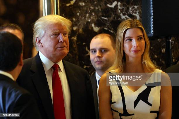 Republican presidential candidate Donald Trump enters a news conference next to his daughter Ivanka at Trump Tower where he addressed issues about...