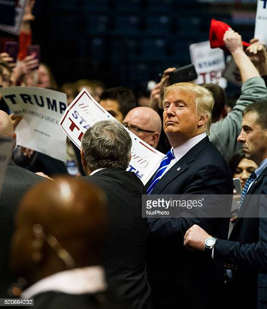Republican presidential candidate Donald Trump exits the arena after speaking at a campaign rally on April 11 2016 in Albany New York The New York...