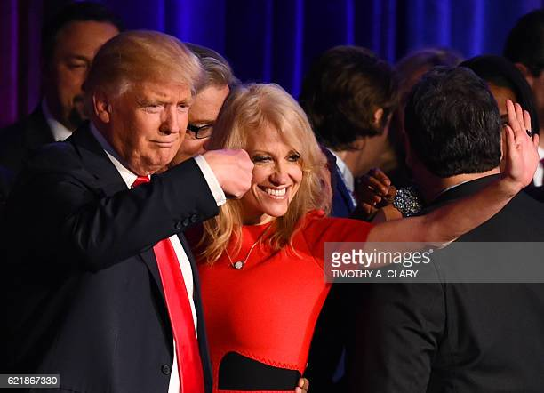 Republican presidential candidate Donald Trump falnked by campaign manager Kellyanne Conway waves to supporters following an address during election...