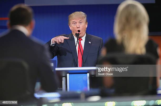 Republican presidential candidate Donald Trump fields a question during the first Republican presidential debate hosted by Fox News and Facebook at...