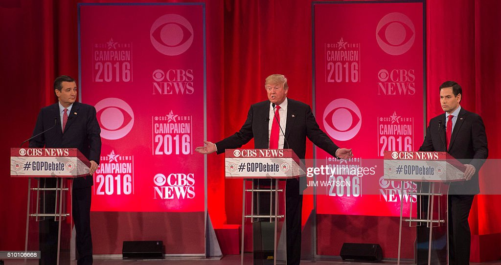 Republican presidential candidate Donald Trump (C) gestures as fellow candidates Ted Cruz (L) and Marco Rubio (R) look on during the CBS News Republican Presidential Debate in Greenville, South Carolina, February 13, 2016. / AFP / JIM WATSON