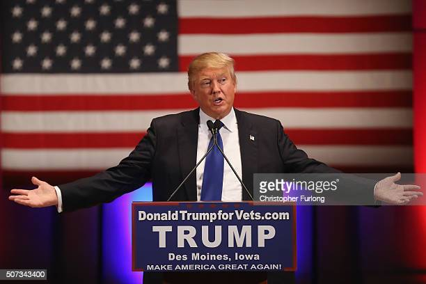 Republican presidential candidate Donald Trump gestures as he speaks to veterans at Drake University on January 28 2016 in Des Moines Iowa Donald...