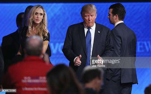 Republican presidential candidate Donald Trump gives a thumbsup as he is joined on stage by his family including daughterinlaw Lara Trump following...