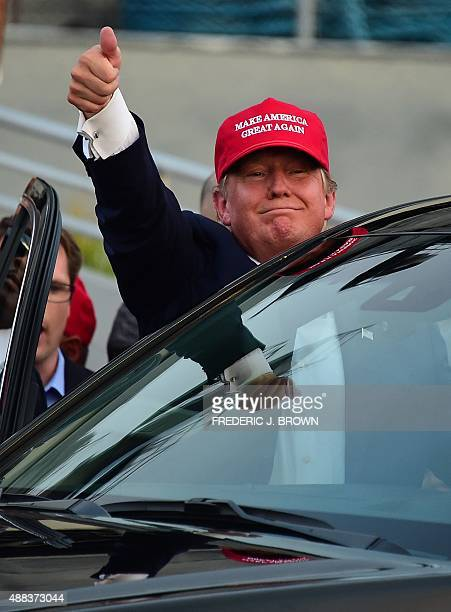 Republican Presidential candidate Donald Trump gives a thumbsup as leaves following a speech on board the Worl War II bettlaship USS Iowa in San...