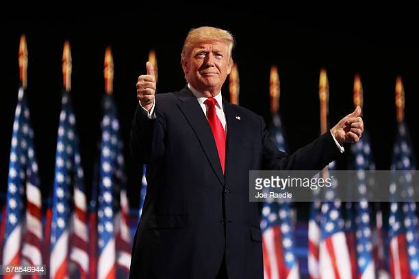 Republican presidential candidate Donald Trump gives two thumbs up to the crowd during the evening session on the fourth day of the Republican...