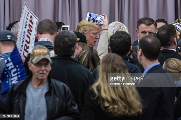 Republican presidential candidate Donald Trump greets audience members following a campaign rally at the Ramada Waterloo Hotel and Convention Center...