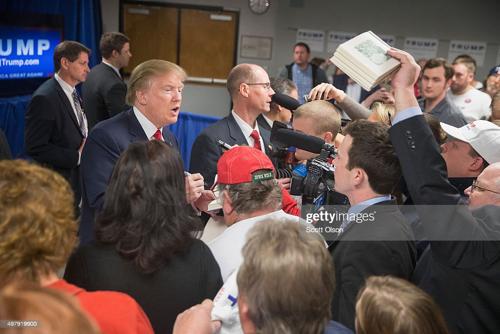 Republican presidential candidate Donald Trump greets guests following a rally at Des Moines Area Community College Newton Campus on November 19, 2015 in Newton, Iowa. Trump is currently leading the race for the Republican presidential nomination in Iowa.