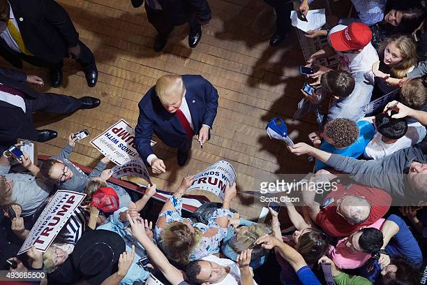 Republican presidential candidate Donald Trump greets guests after speaking at a campaign rally at Burlington Memorial Auditorium on October 21 2015...