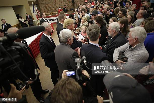 Republican presidential candidate Donald Trump greets guests before speaking at a campaign event January 23 2016 in Pella Iowa Trump who is seeking...