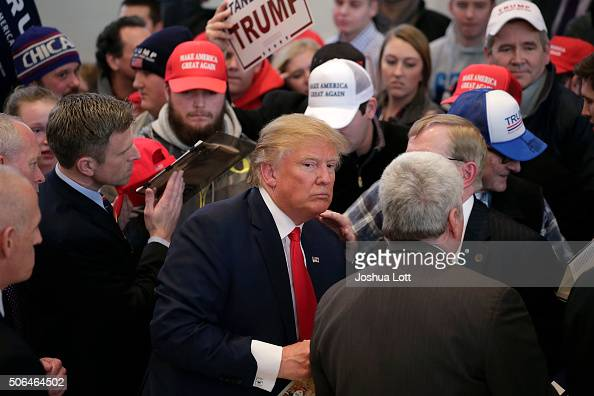 Republican presidential candidate Donald Trump greets guests during a campaign event January 23 2016 in Pella Iowa Trump who is seeking the...