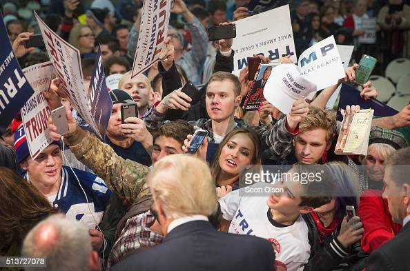 Republican presidential candidate Donald Trump greets guests during a rally at Macomb Community College on March 4 2016 in Warren Michigan Voters in...