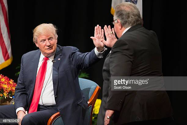 Republican presidential candidate Donald Trump greets his national campaign cochairman Sam Clovis during a town hall meeting at a campaign stop at...