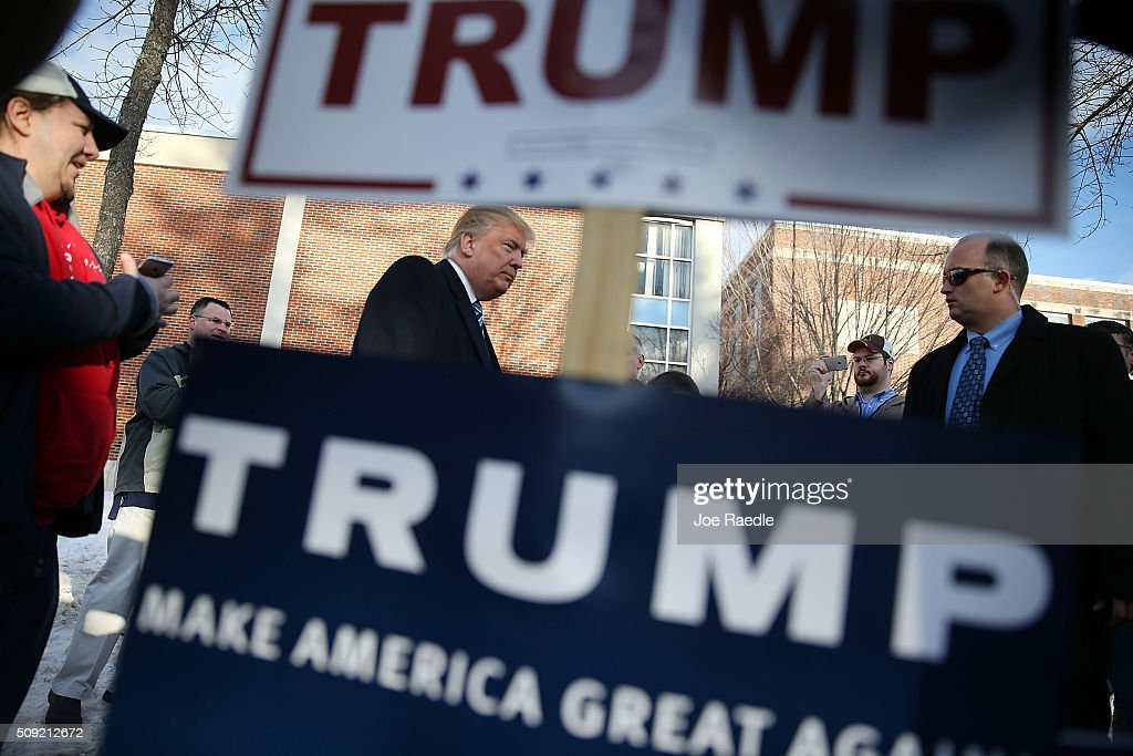 Republican presidential candidate Donald Trump greets people as he visits a polling station as voters cast their primary day ballots on February 9, 2016 in Manchester, New Hampshire. The process to select the next Democratic and Republican Presidential candidates continues.
