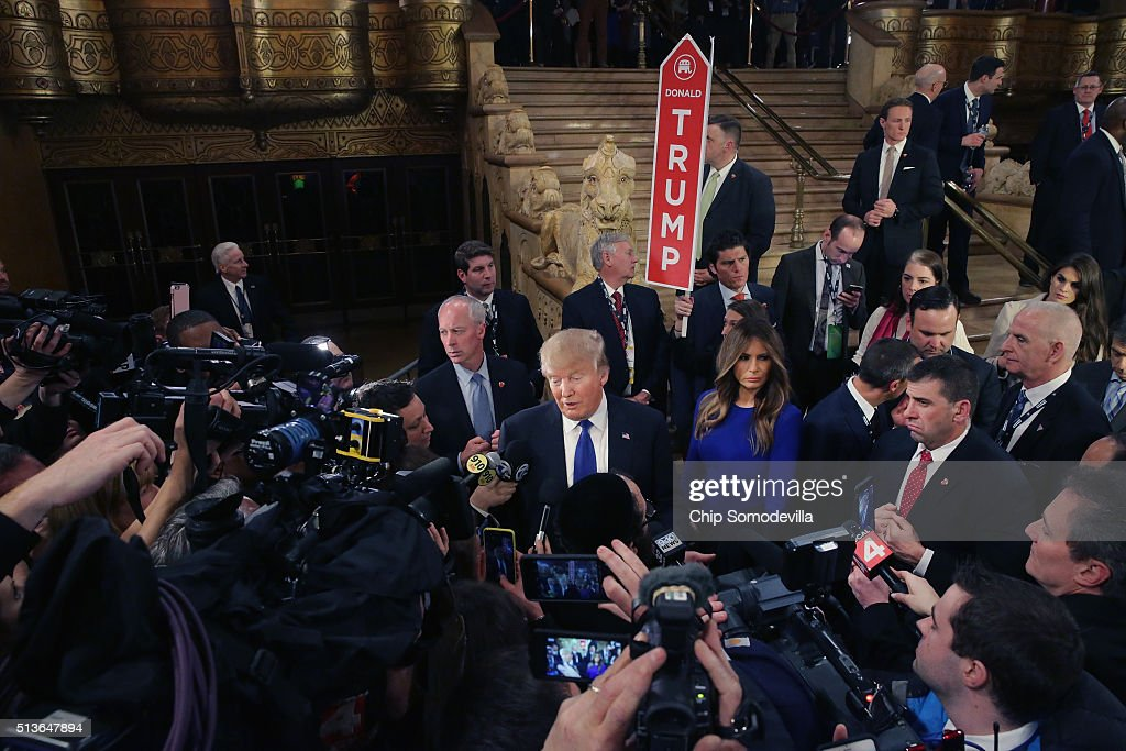 Republican presidential candidate Donald Trump greets reporters in the spin room following a debate sponsored by Fox News at the Fox Theatre on March...