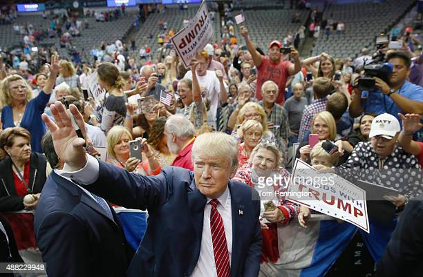 Republican presidential candidate Donald Trump greets supporters during a campaign rally at the American Airlines Center on September 14 2015 in...