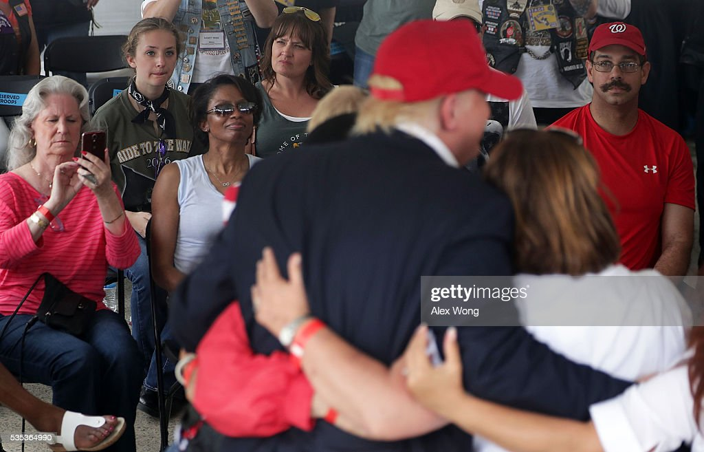 Republican presidential candidate Donald Trump greets with Gold Star family members during the annual Rolling Thunder First Amendment Demonstration Run May 29, 2016 in Washington, DC.Bikers are gathering in the annual parade in the nation's capital to remember those who were prisoners of war and missing in action on Memorial Day weekend.