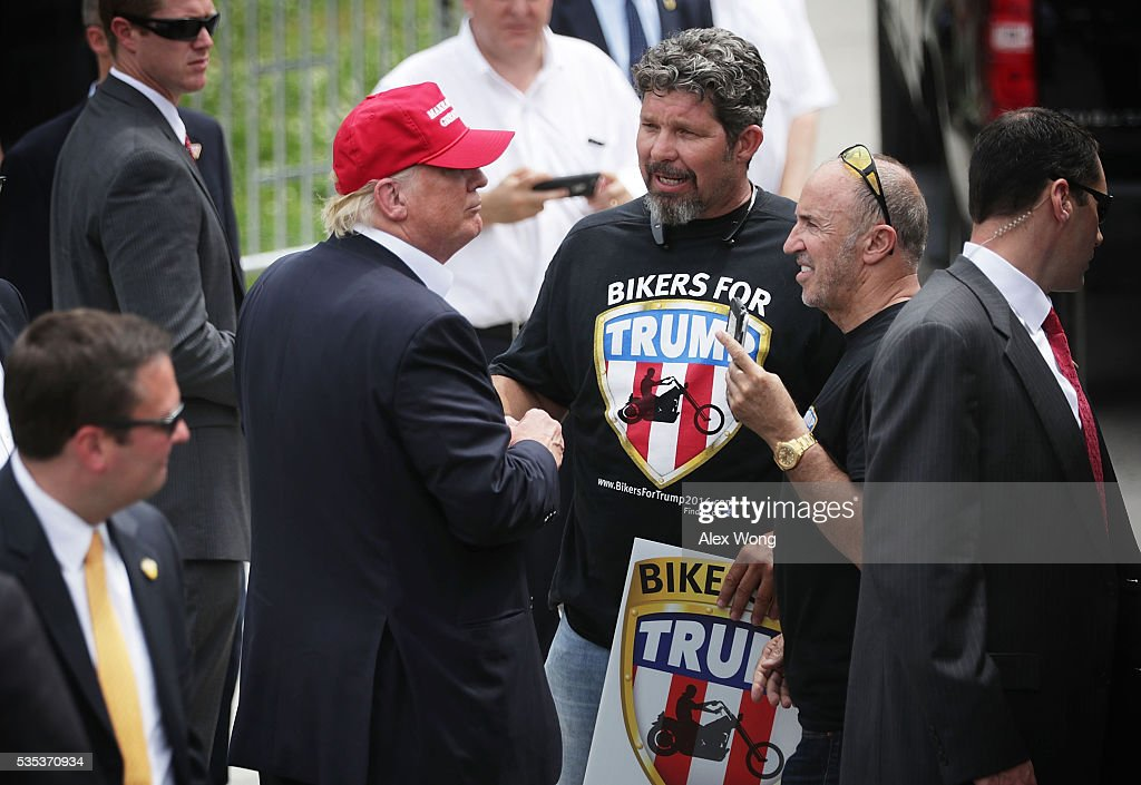 Republican presidential candidate Donald Trump greets with unidentified members of Bikers for Trump during the annual Rolling Thunder First Amendment Demonstration Run May 29, 2016 in Washington, DC. Bikers are gathering in the annual parade in the nation's capital to remember those who were prisoners of war and missing in action on Memorial Day weekend.