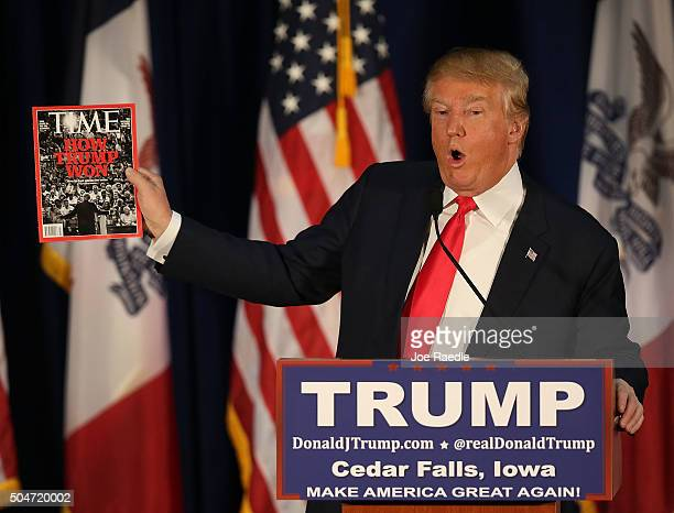 Republican presidential candidate Donald Trump holds up a Time magazine to show off the title of the cover story ' How Trump Won'' during a campaign...