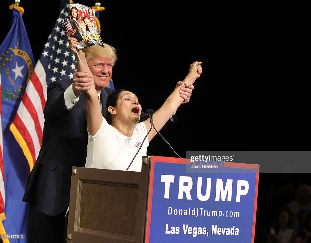 Republican presidential candidate Donald Trump invites Myriam Witcher, 35, of Las Vegas on the stage during a campaign rally at the Treasure Island Hotel & Casino on October 8, 2015 in Las Vegas, Nevada. During the rally, Trump said people were giving him credit for helping force House Majority Leader Kevin McCarthy to bow out of the race for Speaker of the House.