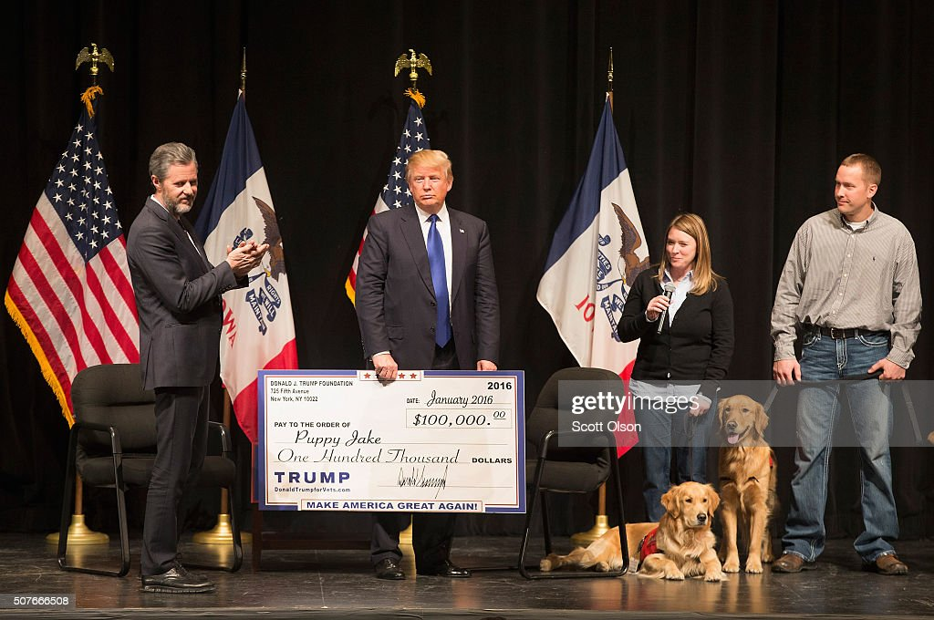 Republican presidential candidate Donald Trump joins Jerry Falwell Jr president of Liberty University for a campaign rally at the Adler Theatre where...