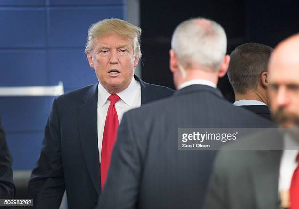 Republican presidential candidate Donald Trump leaves after speaking to the press at a rally on January 26 2016 in Marshalltown Iowa Sheriff Joe...