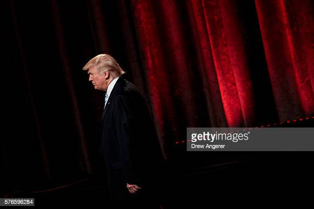 Republican presidential candidate Donald Trump leaves the stage at the end of an event with his newly selected vice presidential running mate Mike...