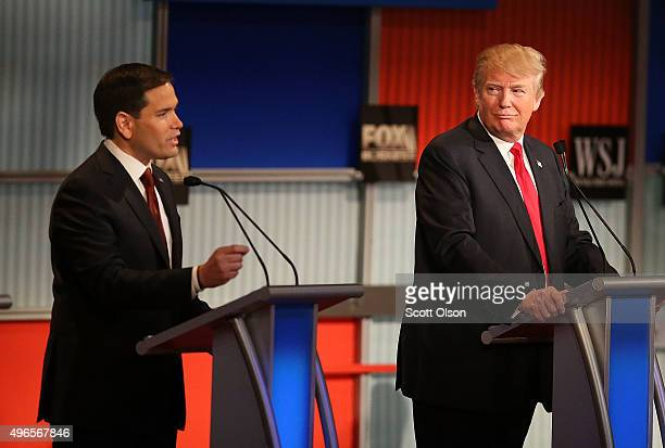 Republican presidential candidate Donald Trump looks on as US Sen Marco Rubio speaks during the Republican Presidential Debate sponsored by Fox...