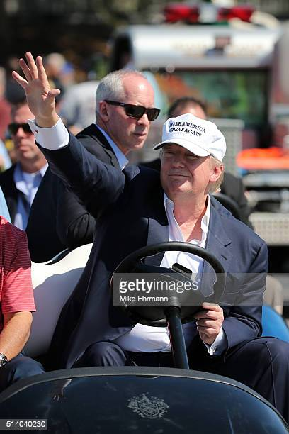 Republican presidential candidate Donald Trump makes an appearance prior to the start of play during the final round of the World Golf...