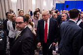 Republican presidential candidate Donald Trump makes his way through he crowd after speaking during a campaign press conference event at the Trump...