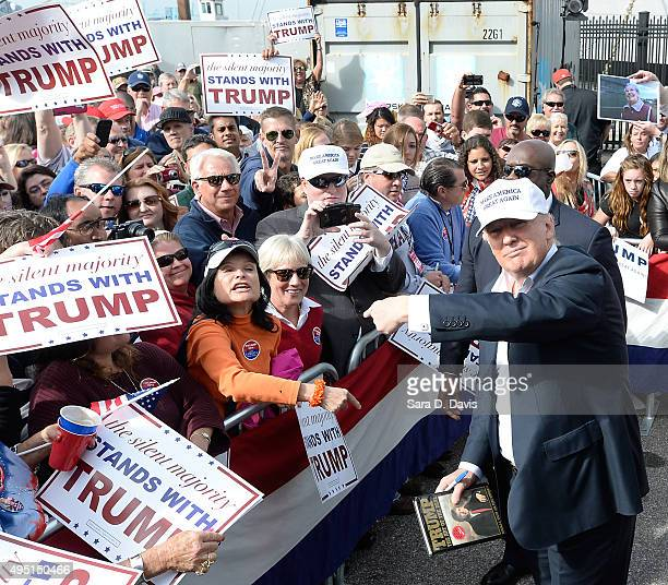 Republican presidential candidate Donald Trump motions to a woman in the audience at a rally in front of the USS Wisconsin on October 31 2015 in...