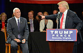 Republican presidential candidate Donald Trump motions to Republican vice presidential candidate Mike Pence during the town hall style meeting at a...